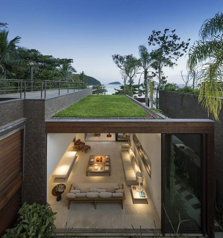 I am in love with the openness of this house. The sod roof acts as a coolant. Four Houses in Baleia / Studio Arthur Casas