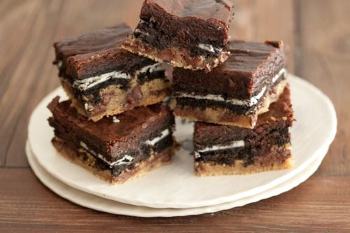 slutty brownies, a super brownie with layers of cookie dough, oreos, and more chocolate