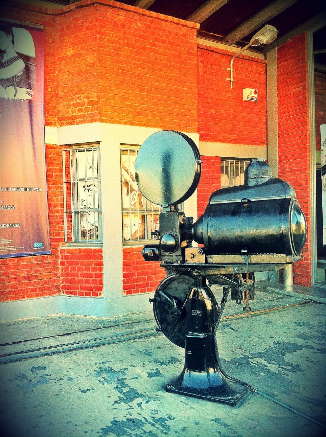 This old projector is placed right next to the entrance of the Museum of Cinema in the port's Warehouse A', to publicize its existence. (Walking Thessaloniki / Route 01, Port)