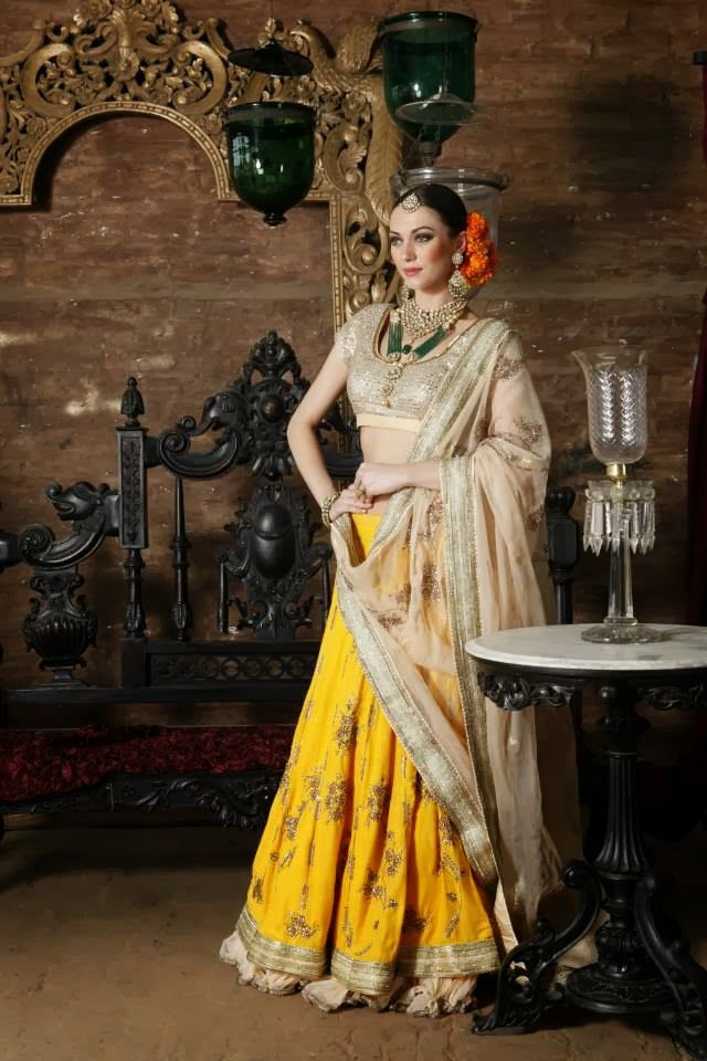 Yellow lengha by Nikasha
