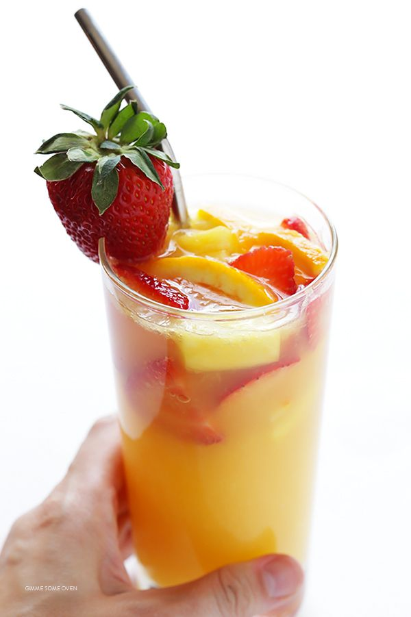 This mimosa sangria recipe is easy to make, chocked full of fresh fruit, and so refreshing and delicious!