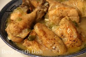 This traditional stewed chicken dish begins with a browned, cut up chicken, that is slow cooked in a roux based gravy.