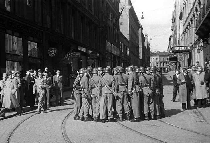 Oslo, May 8th 1945. Rosenkrantz gate. Confused German soldiers after news of the German capitulation break.