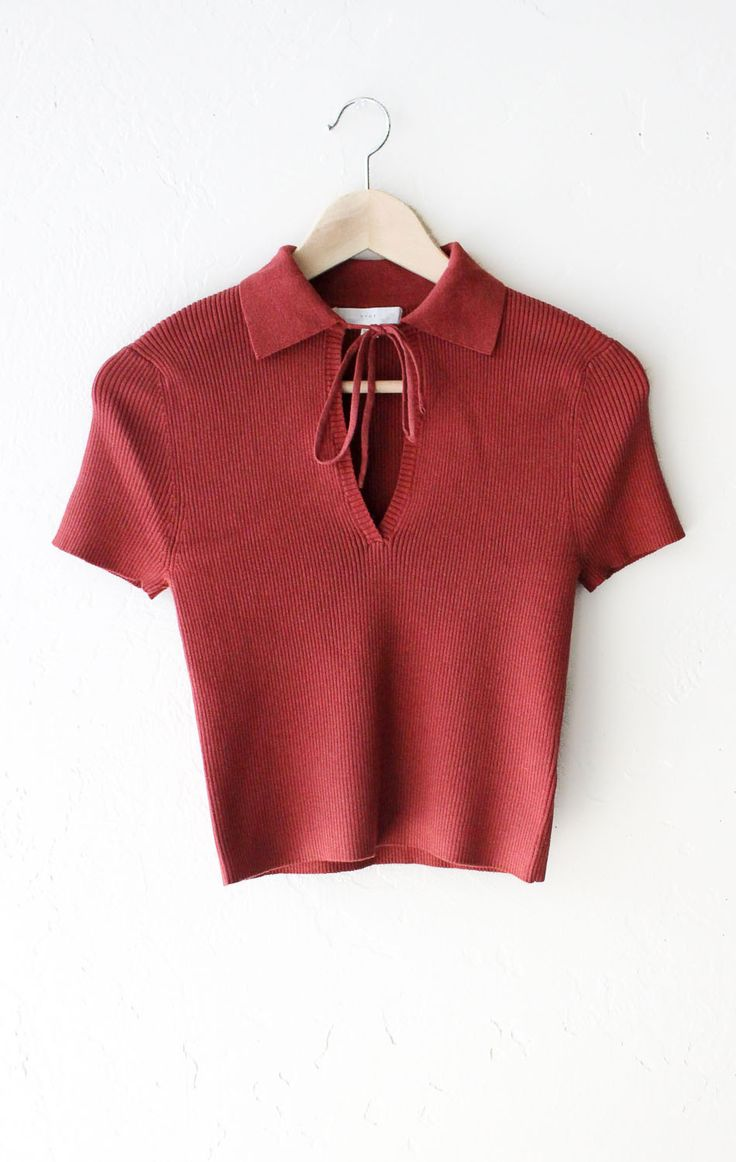 - Description Details: Super cute short sleeved v-neck crop top in rust with self-tie accent & basic collar. Form fitting, tend to run on the smaller side & are more fitted. Measurements: (Size Guide)
