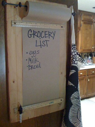 A roll of brown paper makes a seemingly infinite place for grocery lists. | 30 Insanely Easy Ways To Improve Your Kitchen