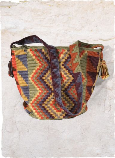 Tribal geometrics are handcrocheted in our pima duffle; shoulder strap; zip top; circular bottom.