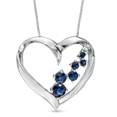 A pathway of deep blue sapphires meanders between the lines of this 14K white gold heart pendant.