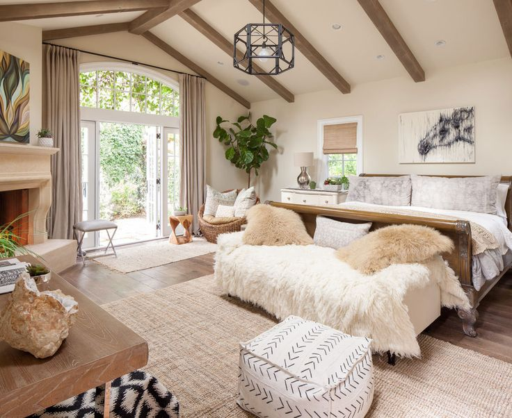 Soft throws, a wood-burning fireplace, and a varied array of plantings turn the master bedroom into a cocoon.