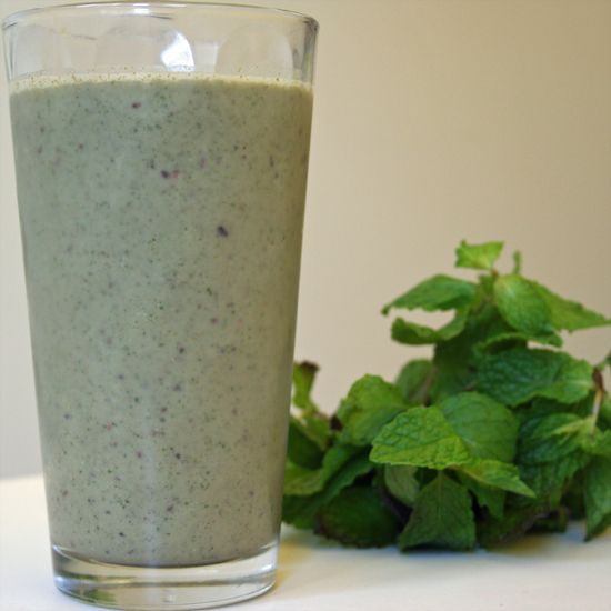 Dairy-Free and Sugar-Free Mint Chocolate Chip Shake 1 tablespoon raw cacao nibs 1/2 teaspoon vanilla extract 1/2 cup dairy-free vanilla ice cream (like So Delicious) 1 handful mint leaves (stems OK) 2 teaspoons or half a packet of Green Vibrance green food supplement (optional) 3 large ice cubes 1/2 cup or more unsweetened almond milk Pinch of Himalayan sea salt