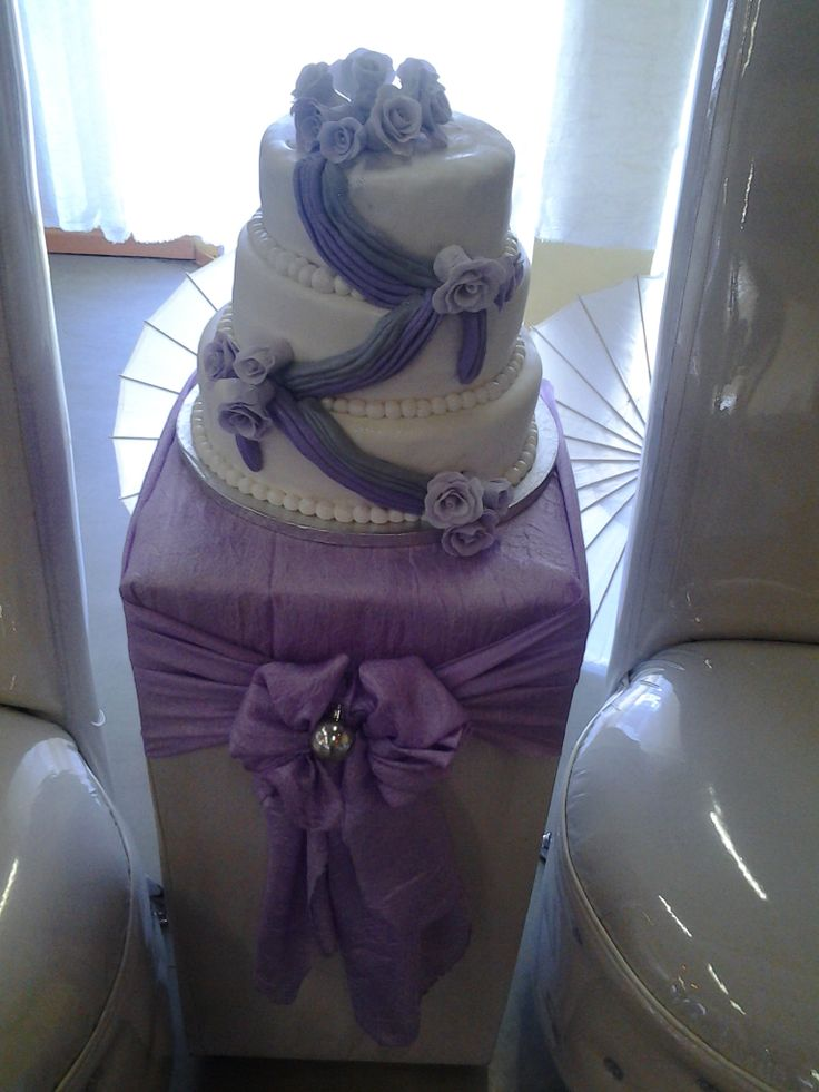 draped lillac and white cake with roses