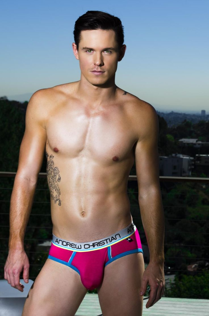Young Lean Shirtless Male Model Wearing A Bubble Gum Pink
