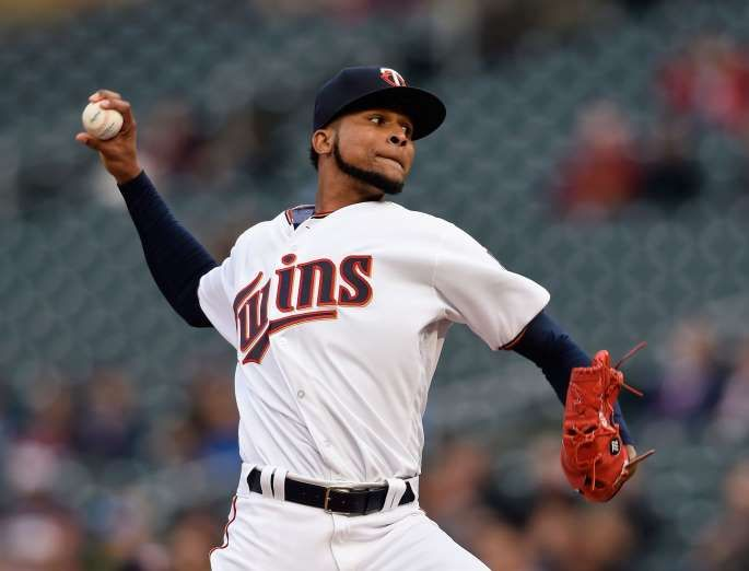 GRIPPING IT AND RIPPING IT:    Ervin Santana of the Minnesota Twins delivers a pitch against the Oakland Athletics during the first inning on May 2 at Target Field in Minneapolis. The Twins won 9-1.