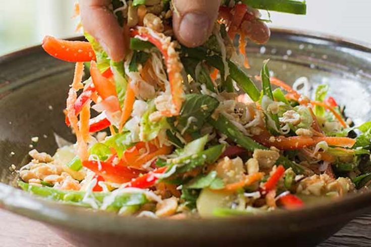 This is a variation of the Thai green papaya salad called som tum, using more commonly available ingredients. I often blanch green beans to make them a little softer to bite into but slicing them lengthwise achieves the same result and makes them a lot like papaya strips. Cabbage and carrot are natural partners and it makes a big difference how you prepare them. Slice the cabbage as thinly as possible to bring out the juiciness, but grate the carrot on a coarse grater so it doesn't ...