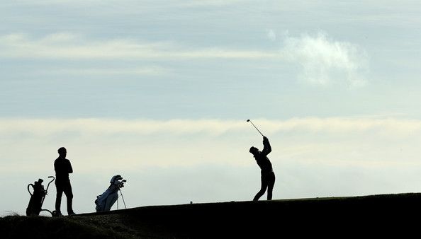 Alex Howe tees off on the fifth hole against C.A.Smith during the third round matches of the 2015 Oxford and Cambridge Golf Society President's Putter at Ry Golf Club on January 9, 2015 in Rye, England. (January 8, 2015 - Source: David Cannon/Getty Images Europe)