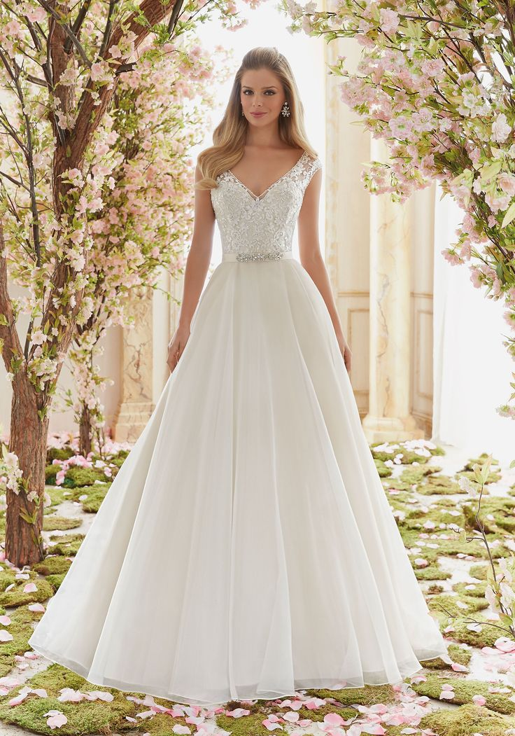 Mori Lee - 6836 Delicately Beaded Embroidery on Organza Wedding Dress Designed by Madeline Gardner. Removable Beaded Satin Belt included. Colors: White, Ivory, Ivory/Champagne