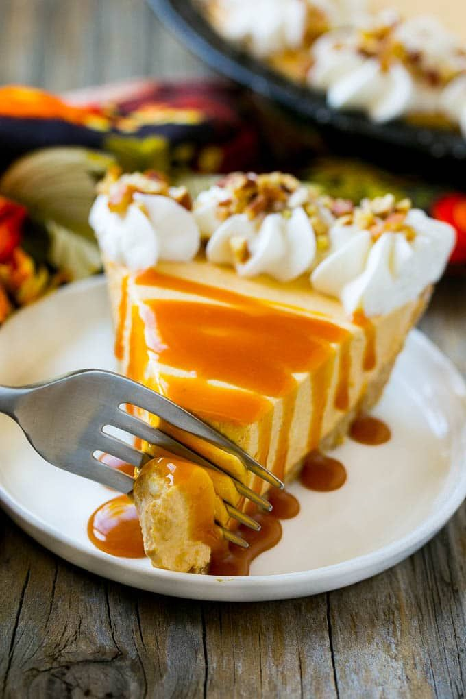This no bake pumpkin cheesecake recipe is rich, creamy and so simple to make. Top it with caramel sauce for the perfect finish to any fall meal or holiday!