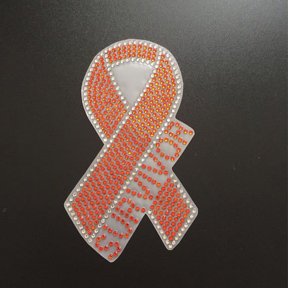 This awareness ribbon decal is sure to dazzle up your vehicle. Customized with the word of your choice; Survivor, Support, Awareness, Cure or Fight. It is approximately 6.43 inches tall x 3.6 inches wide.  The second picture shows all of the options.  The rhinestones are orange with a crystal outline. Application is easy! 1. Clean area you want to apply it to. 2. Slowly peel away the decal from one corner. 3. Apply the design to the chosen, clean spot ONE time. Be sure to place it where you…