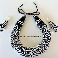 www.cewax.fr aime les bijoux ethno tendance Bijoux ethniques et style tribal. Retrouvez tous les articles sur la mode afro sur le blog de CéWax: cewax.wordpress.com/ Collier noir et blanc ethnique en tissu et cuir  motifs ethniques chics