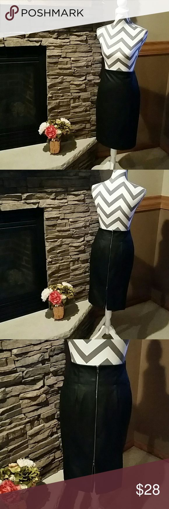Faux Leather Pencil Skirt Adorable penciled skirt with zipper slit back. Top back latch is thread and hook in addition to the zipper. Express Skirts