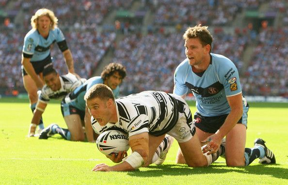 Kirk Yeaman of Hull celebrates scoring his 2nd try during the Carnegie Challenge Cup Final between Hull FC and St Helens at Wembley Stadium in London, on August 30, 2008.
