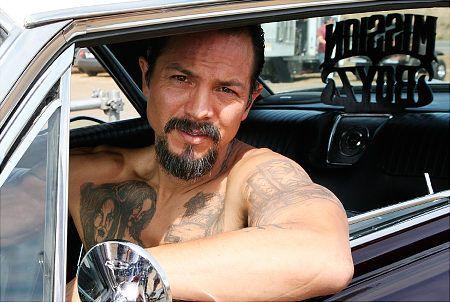 Yeah...i like him tatted and scruffy...mmmm  Benjamin Bratt lowriding....