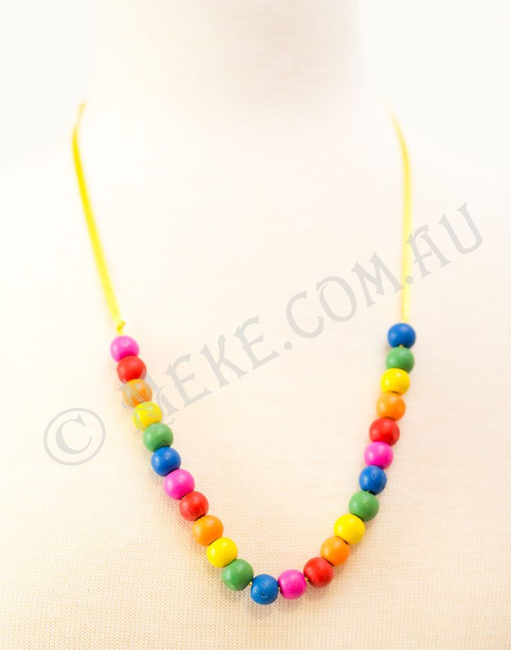 : : Rainbow Bright Necklace : :  Your special little lady can enjoy the rainbow without the rain in this bright and fun handcrafted children's necklace! The necklace features a bright rainbow of pink, red, orange, yellow, green and blue round timber beads on a vibrant yellow ribbon.  Visit my Etsy store for more info, or to purchase: https://www.etsy.com/au/listing/153871563/rainbow-bright-childrens-necklace?ref=shop_home_active  Handmade with love and care by Marianne ❤