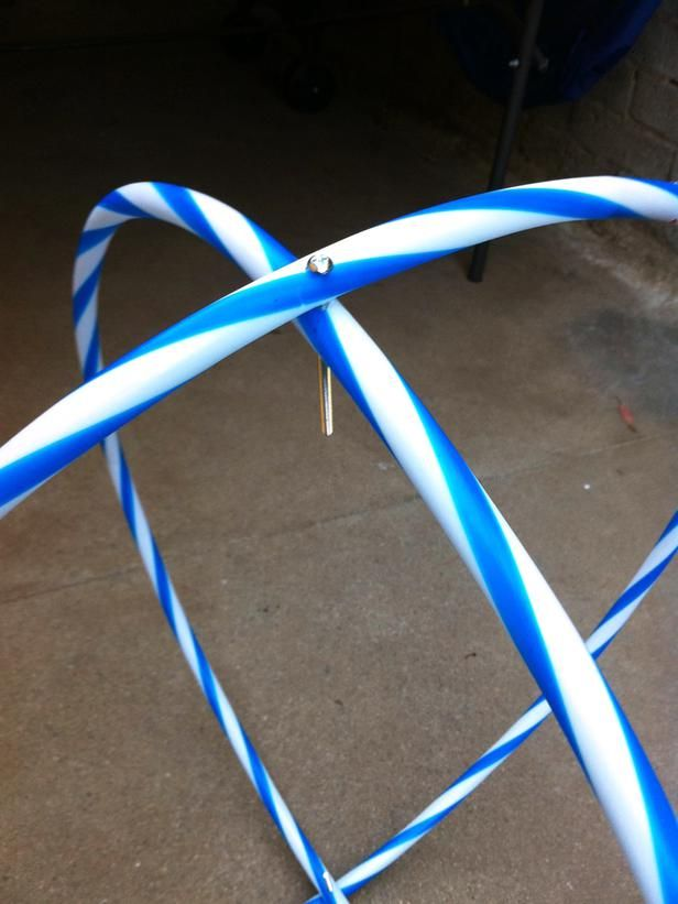 Begin Assembly in How to Make a Hula-Hoop Chandelier from HGTV