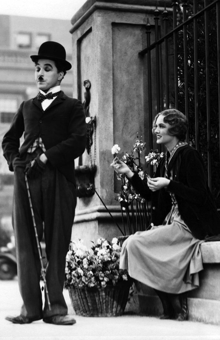 """City Lights"" Charlie Chaplin Virginia Cherrill 1936 ~ When the film opened, Albert Einstein joined Charles Chaplin at the theater. When the film opened in England, George Bernard Shaw joined him. Orson Welles said that this was his favorite movie of all time. Charles Chaplin's personal favorite of all his films. (IMDB)"