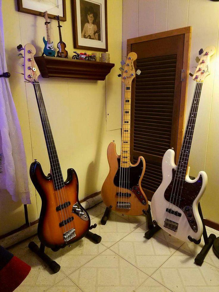 My three Fender Jazz basses.