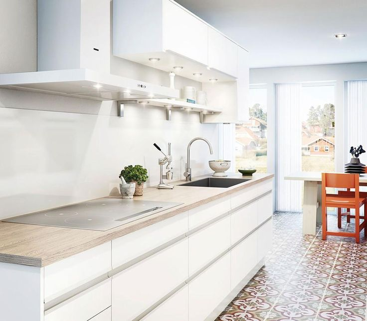 http://taizh.com/wp-content/uploads/2014/10/awesome-kitchen-design-with-white-cabinet-storage-and-floral-pattern-floor-and-glass-wondow-as-well-lighting-under-the-cabinet.jpg