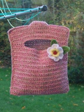 Crochet pegs bag  @Amanda Snelson Lucas maybe something like this for Michelle? Maybe you can write a knit pattern?