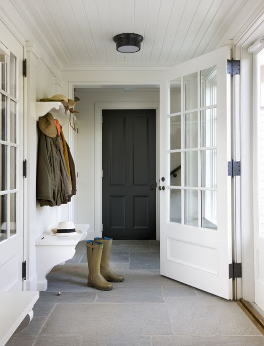 Entry way, large field stone tiles and broad white doors, give this a welcoming country feel #mudroom