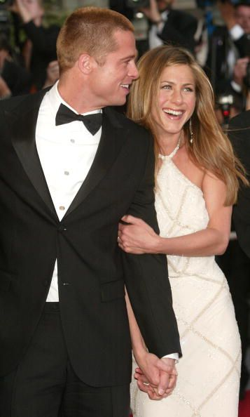 Memorable Moments at the Cannes Film Festival: One of Brad and Jen's last red carpet appearances together in 2004. :(