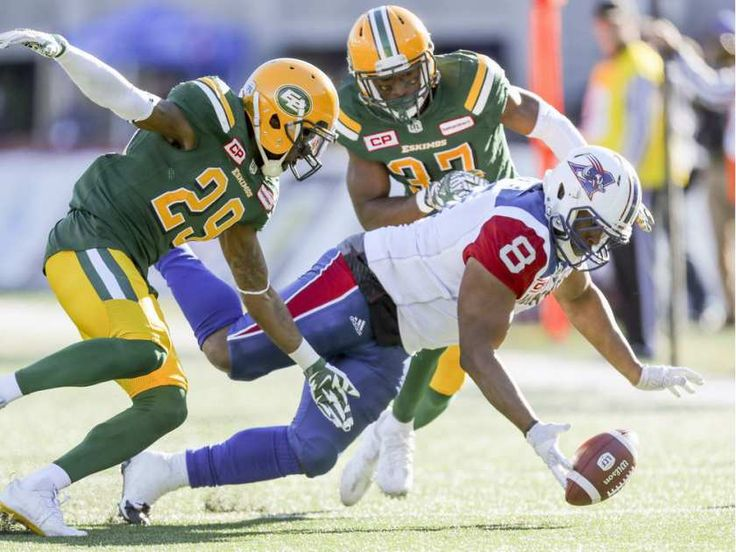 WK 16 - Edm.40 - Mtl.20 - Montreal Alouettes' #8 Nik Lewis dives for the football that he fumbled after making a catch, pursued by Edmonton Eskimos #29 Cord Parks, left, and #37 Kenny Ladler  during CFL action at Molson Stadium in Montreal on Monday, Oct. 10, 2016.