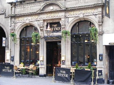 Best of Edinburgh Pubs - The Mitre The Mitre is a popular traditional pub which enjoys a prime location on the High Street. Grab a seat outside on a nice day, relax with a drink and watch the world go by. Inside, there is a nice ambience and interesting features. Serves food. Frequent live music.