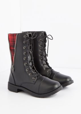Fall in, soldier! This trendy combat boot is constructed with essential details like lacing and a lug sole, it's primary feature is a cool exposed zipper detail up the side with an inset panel of textured plaid wool.