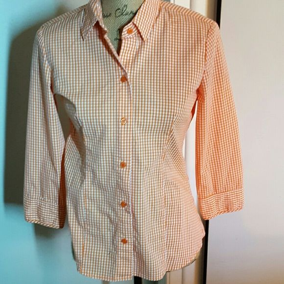 New York & Style orange& white gingham top In excellent condition.  New York & Style orange & white gingham check blouse. Button down style, cotton blend fitted style with stretch, hanger loop with pleat in back, 3/4 length button cuffed sleeves. Really cute top that is very versatile for skirts, shorts and pants. You'll love it! New York & Company Tops Button Down Shirts