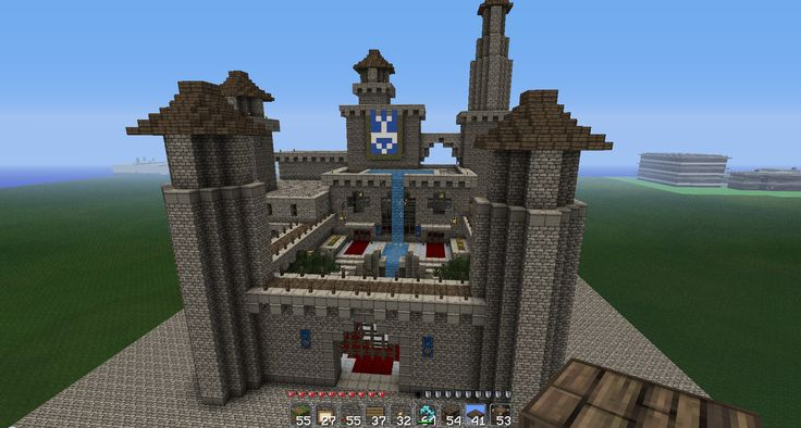 Minecraft Castle ideas: I love the courtyard and especially love the waterfall. :)
