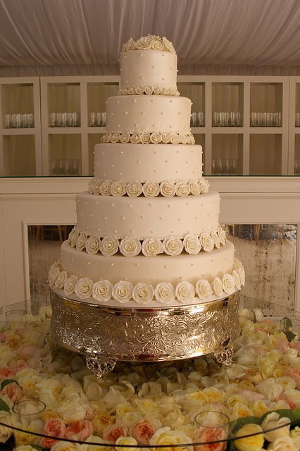 Fondant Iced Wedding Cake Floating Tier Separated By Handmade Gum Paste Roses In Descending Sizes
