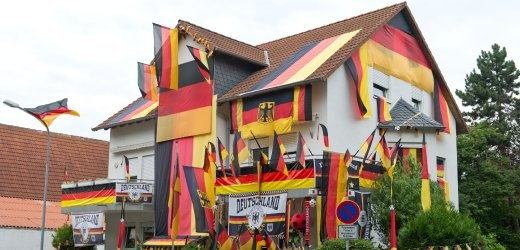 "a true football fanatic, 28-year-old dennis rheinhardt has decorated his family home in eppstein, near frankfurt, with german flags to show support for his country's football team. ""die mannschaft,"" or ""the team,"" has reached the semi-finals of the 2012 european football championship, playing an undefeated tournament so far. but they will have to beat italy in the next match to proceed to the final."