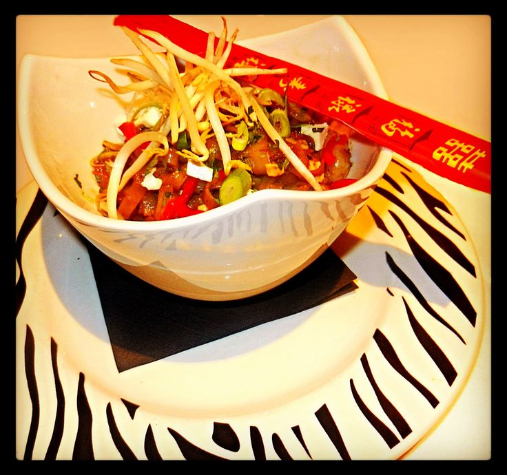 Wiki Wiki Stir Fry: A Wild Wok carnival of spiced shredded beef, Japanese soba noodles, chilli, carrots, onions & sugar snap peas, all tossed in a soy & ginger sauce and garnished with spring onions, dried chilli flakes & bean sprouts.