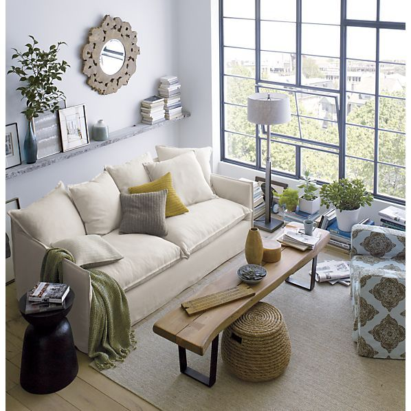 Love this narrow bench/coffee table for living room...also, maybe move couch away from wall a bit?