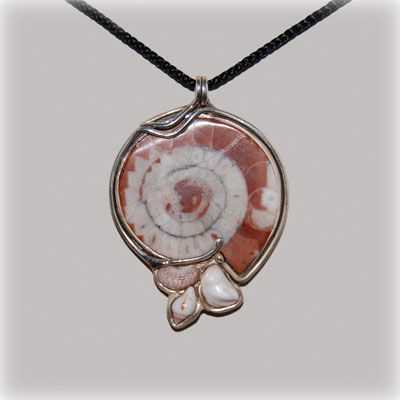 Fossil of ammonite entirely handmade in our workshop.