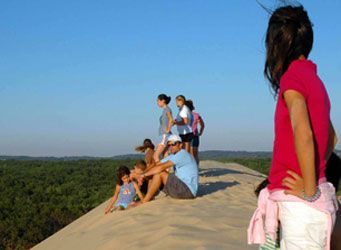 A View Worth the Climb-- Bordering Lake Michigan and Silver Lake, these sand dunes consist of nearly 2,000 acres of rolling sand hills 1.5 miles wide and 3 miles long. Still growing and moving, it is one of the largest deposits of living dunes on the Lake Michigan shores.  Photo courtesy of Silver Lake Dunes-Hart Visitors Bureau