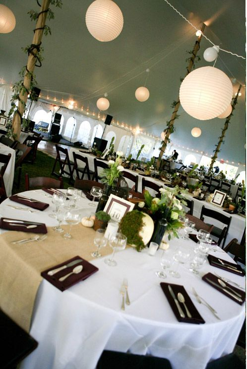 Alternate burlap runners with navy/white striped runners, navy napkins, white base tablecloth.  Tent should have lots of twinkle lights and lanterns.