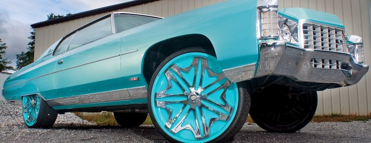 HOW WOULD A PAIR OF TURQUOISE TIP CAR EYELASHES LOOK ON THIS BABY!!! THIS VEHICLE IS JUST WILD!! KINDA LIKE IT THOUGH! ;) Dubs will be available on my site soon. If you want them now, message me, we can have it arranged! (519) 562-7530 or nnekasessentials@gmail.com