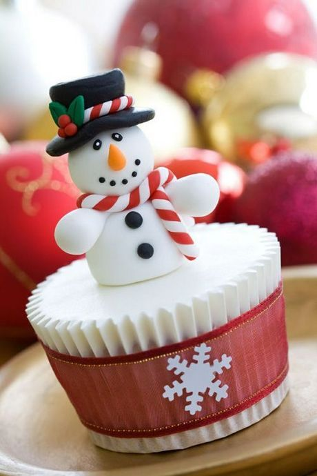 Christmas cupcake decorated with a cheerful snowman