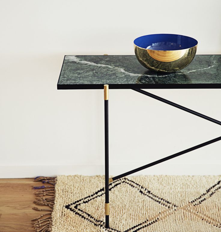 The HANDVÄRK Console // Brass on Black // Green Marble - decorated with a bowl designed by Louise Roe.