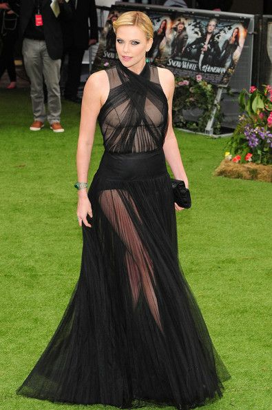 Charlize Theron in dark, romantic Christian Dior couture.