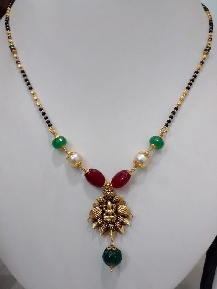 Beautiful emerald Ruby & south sea pearls studded blackbeads necklace with antique pendent